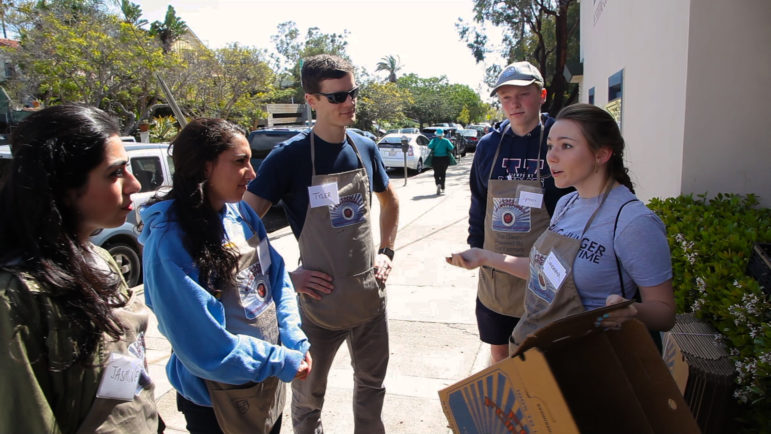 A group of student volunteers at a Farmers Market