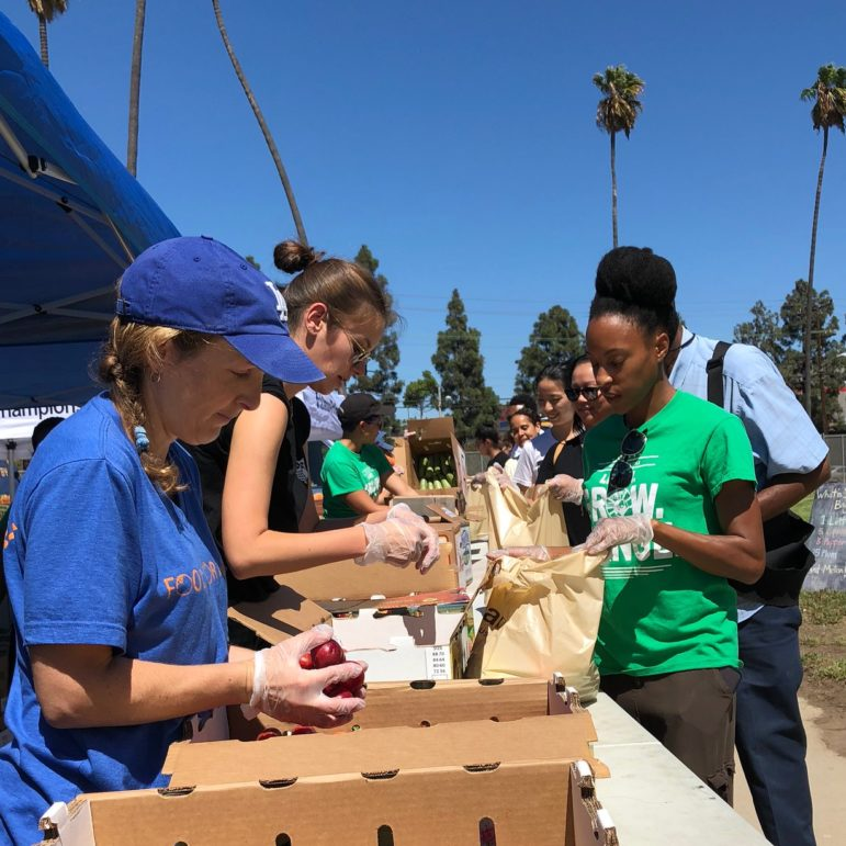 Volunteers make bags of produce for a Produce Pick Up