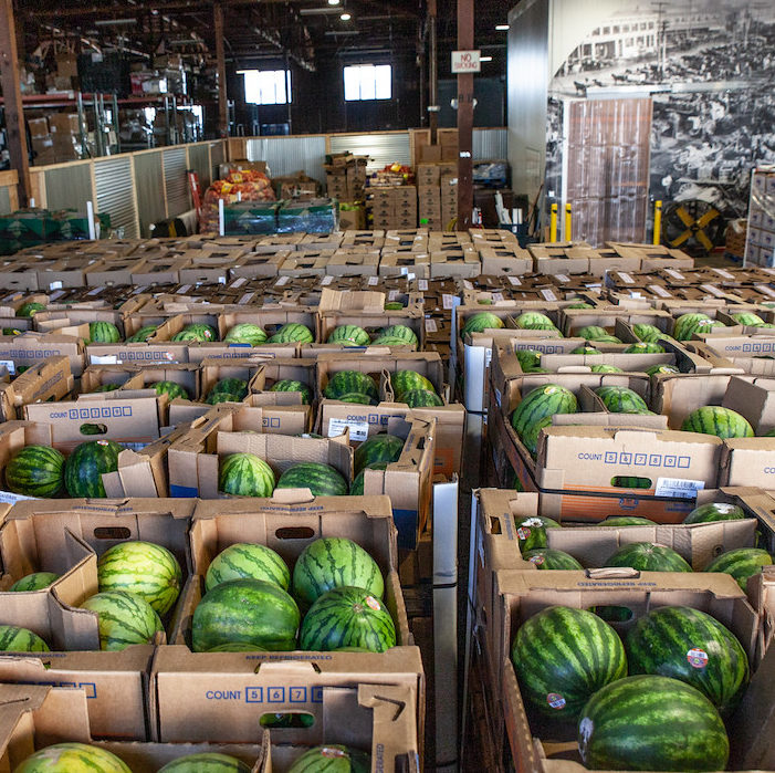 Boxes and boxes full of watermelon at the Food Forward Pit Stop