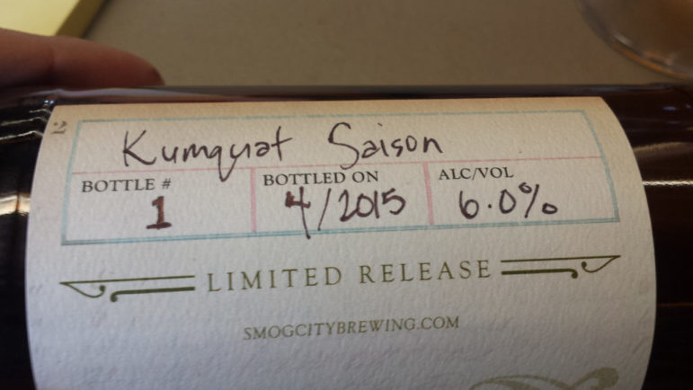 A label of Kumquat Saison, that denotes the bottling date and alcohol percentage.