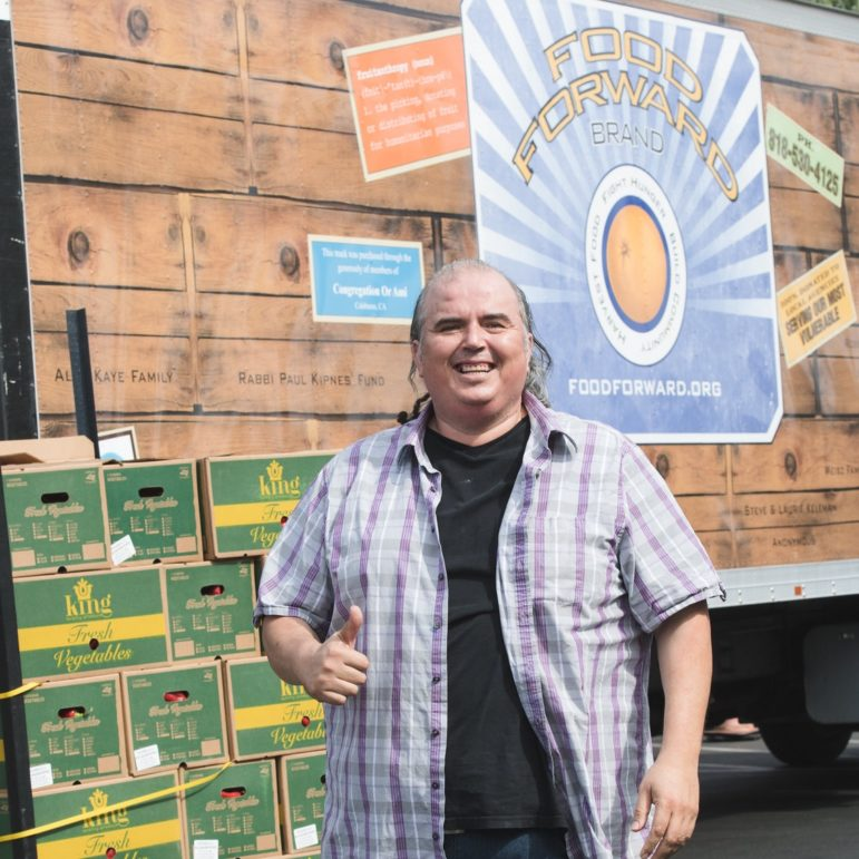 Luis Yepiz of Food Forward in front of a truck