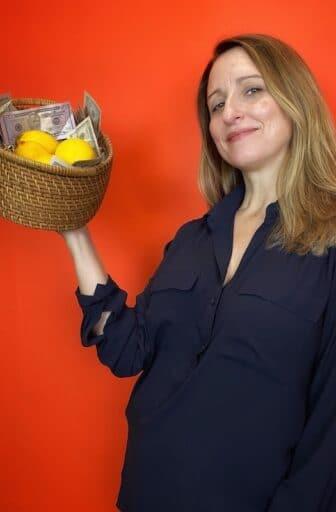 Jen with basket of lemons and money